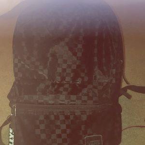 Tillys checkard backpack